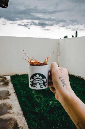 person-holding-starbucks-cup-with-brown-beverage-903419