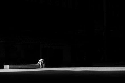 man-sitting-on-a-concrete-bench-373914