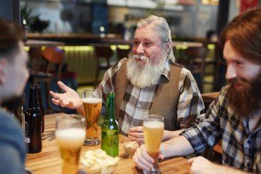 men-talking-at-a-bar-3851380